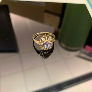 Amethyst and diamond 14 k gold ring.